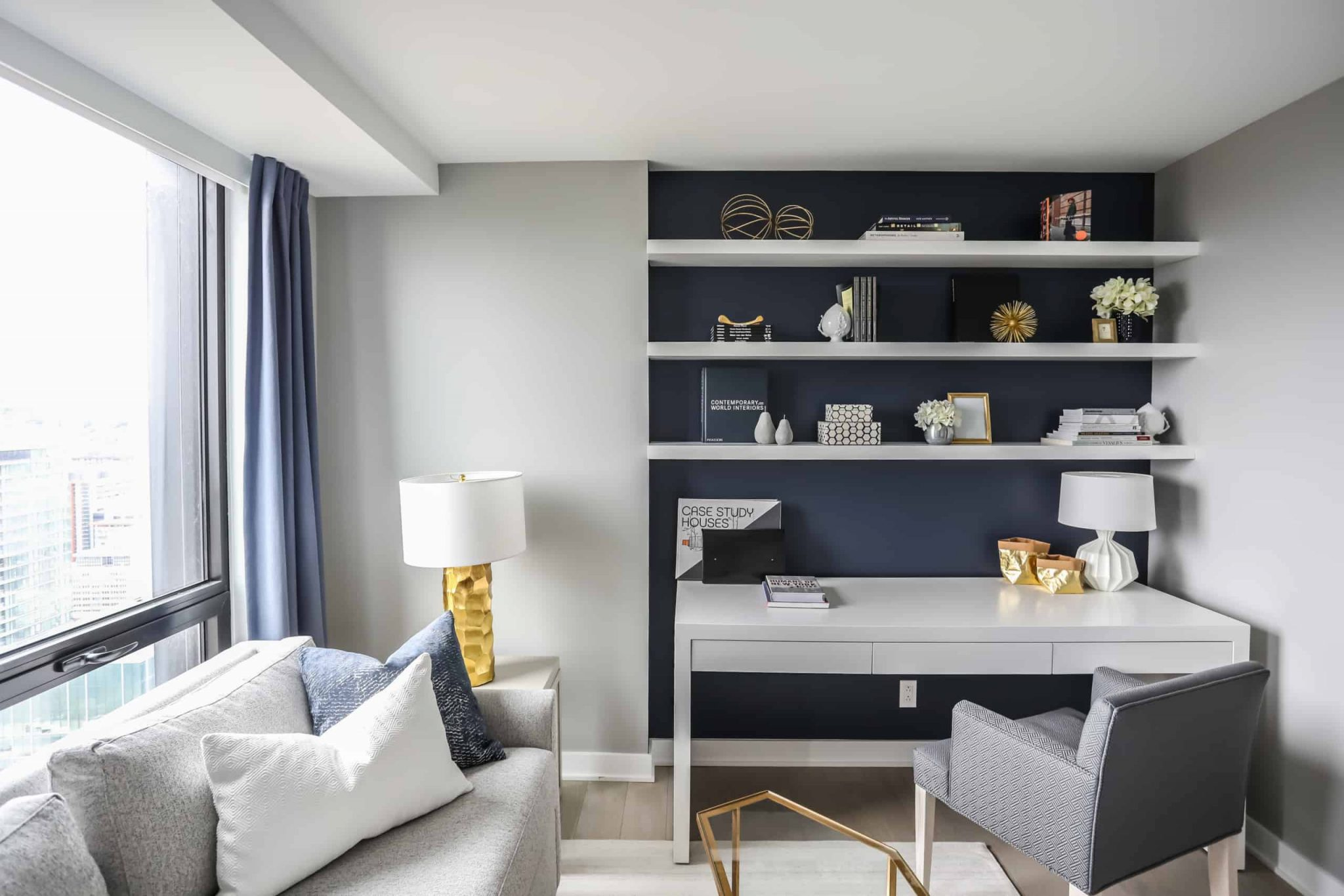 Small workspace with three shelves above it