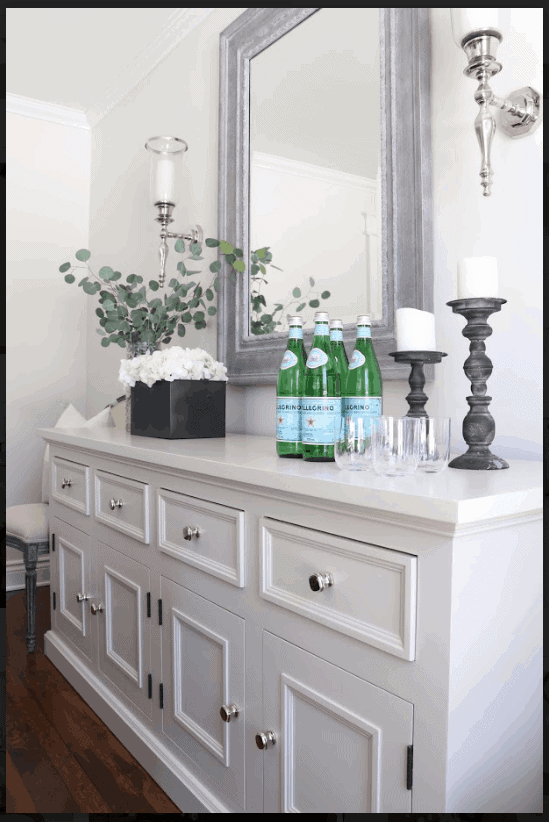 Large white dresser with drinks on it