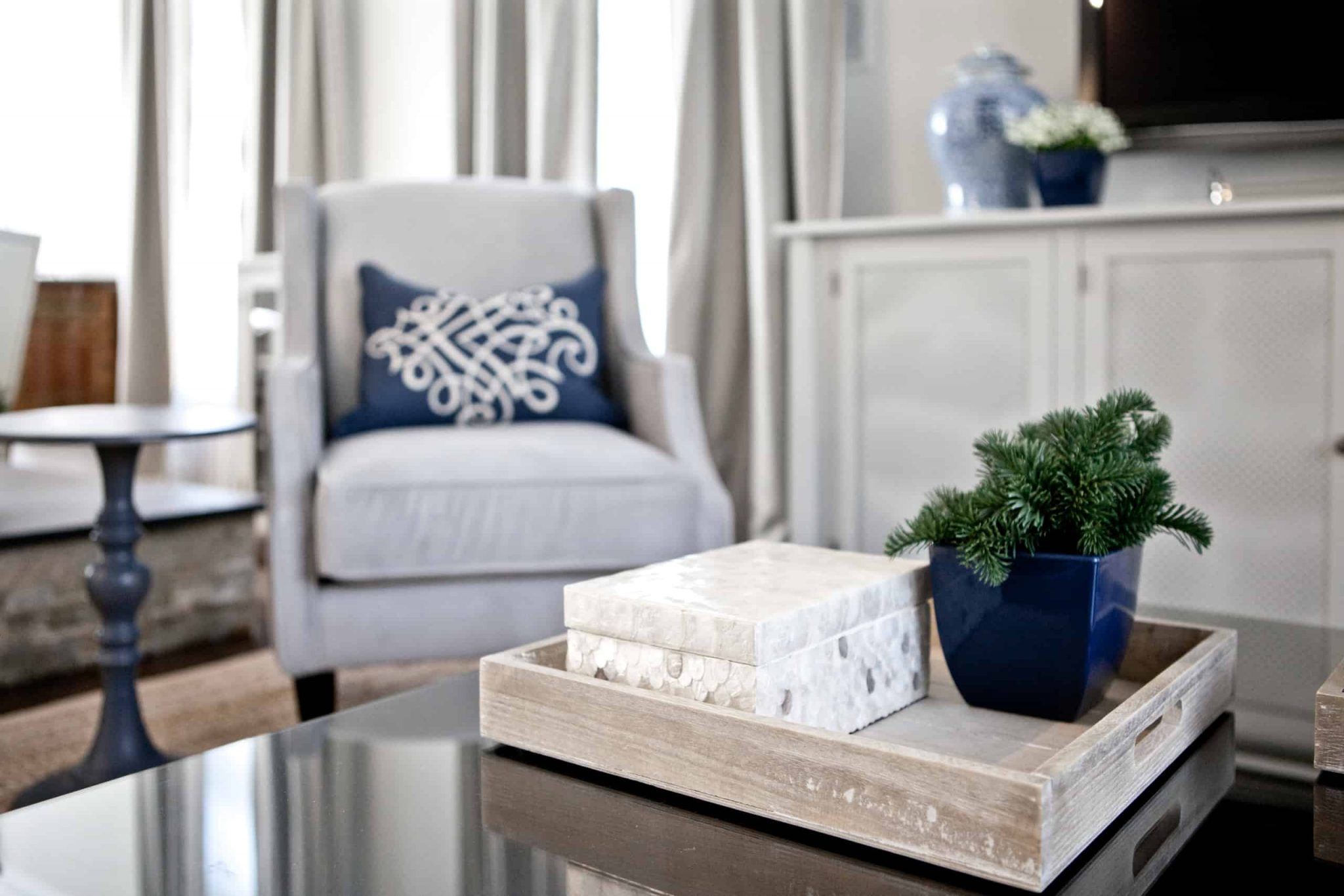 Wooden decorative tray on a black coffee table