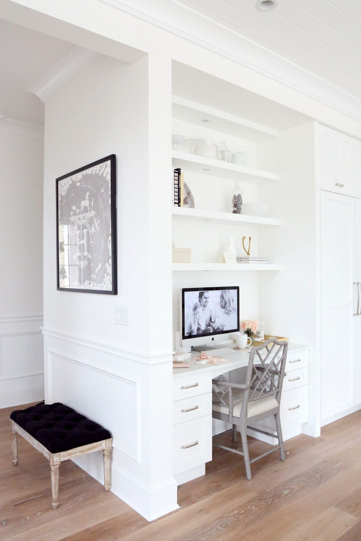 Bright, modern workspace with a decorative shelving unit above it