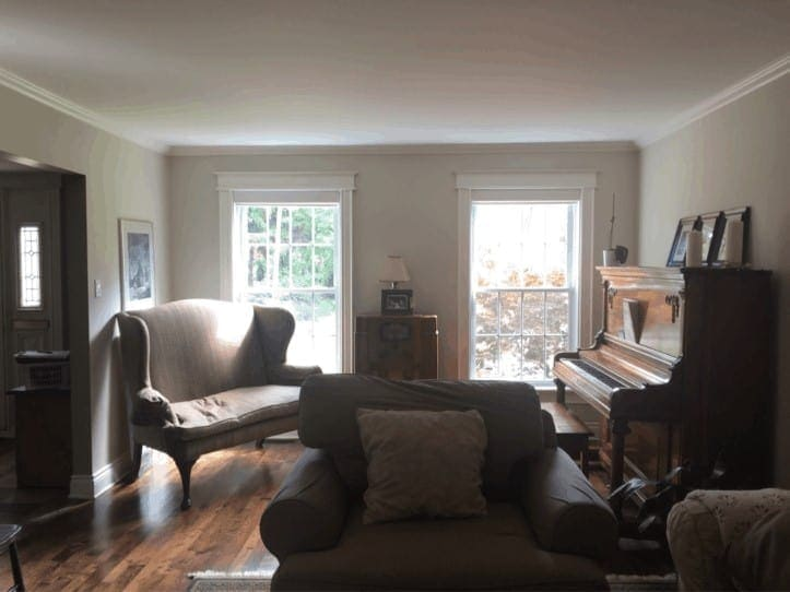 Dark family room with a piano in the corner