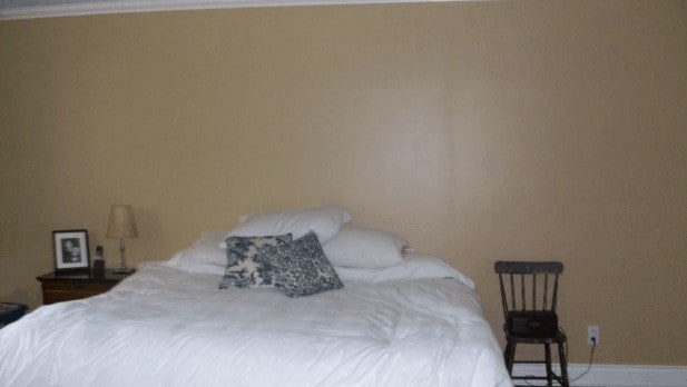 Dark bedroom with a brown wall