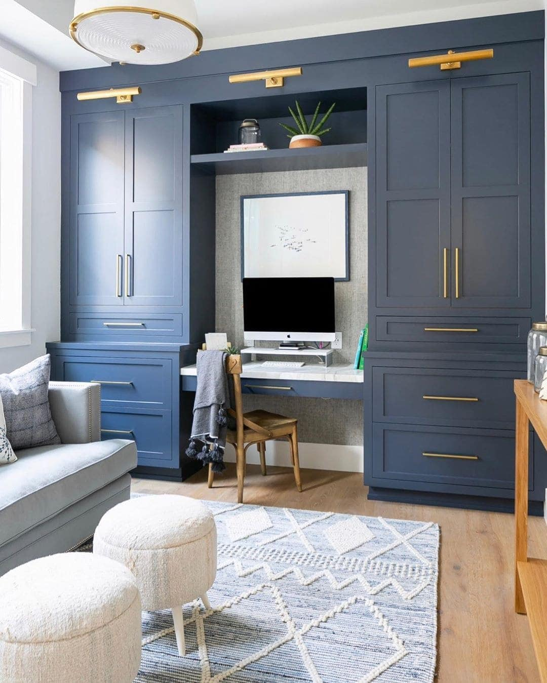 Small office with blue drawers next to the desk