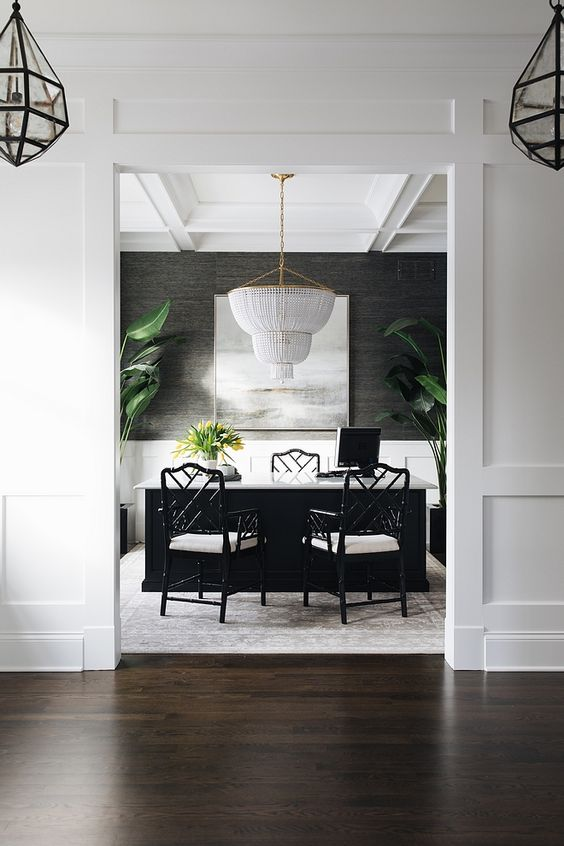 Bright, modern dining room with a black and white color scheme