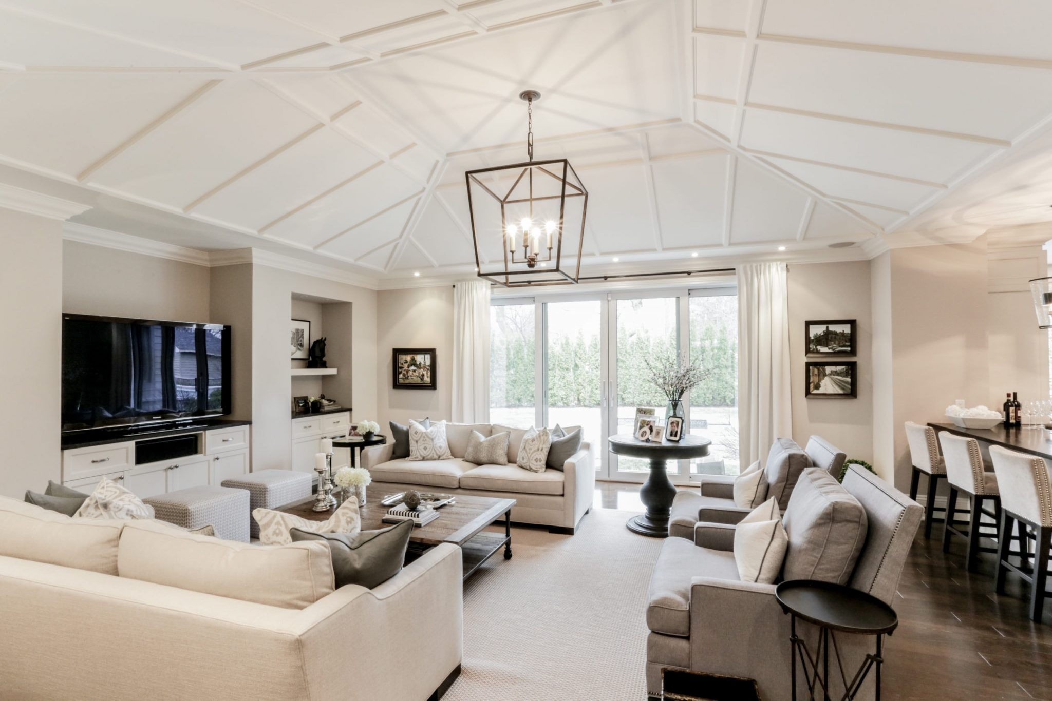 Large, tall living room with a small chandelier