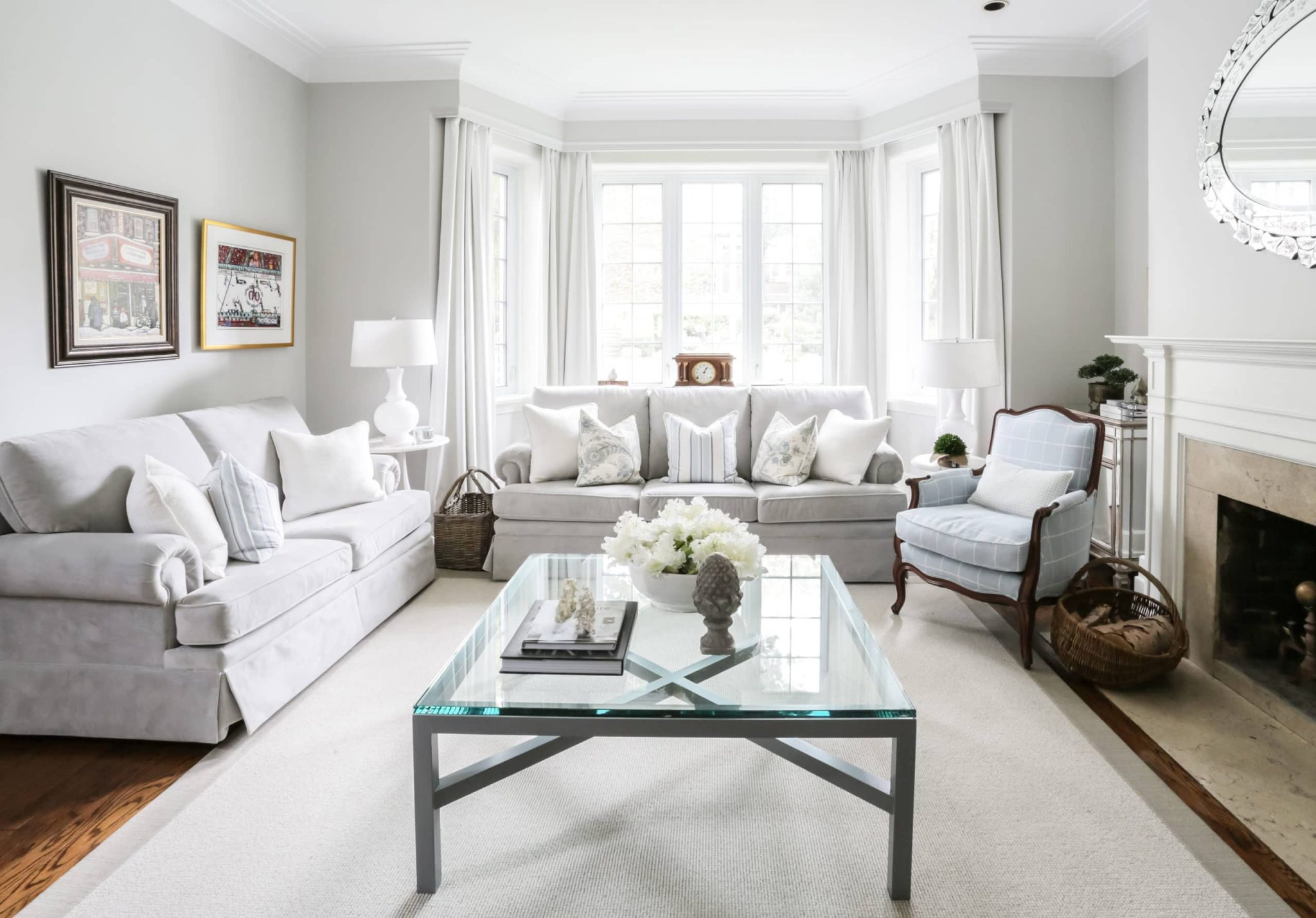 Bright living room with a glass coffee table in the center