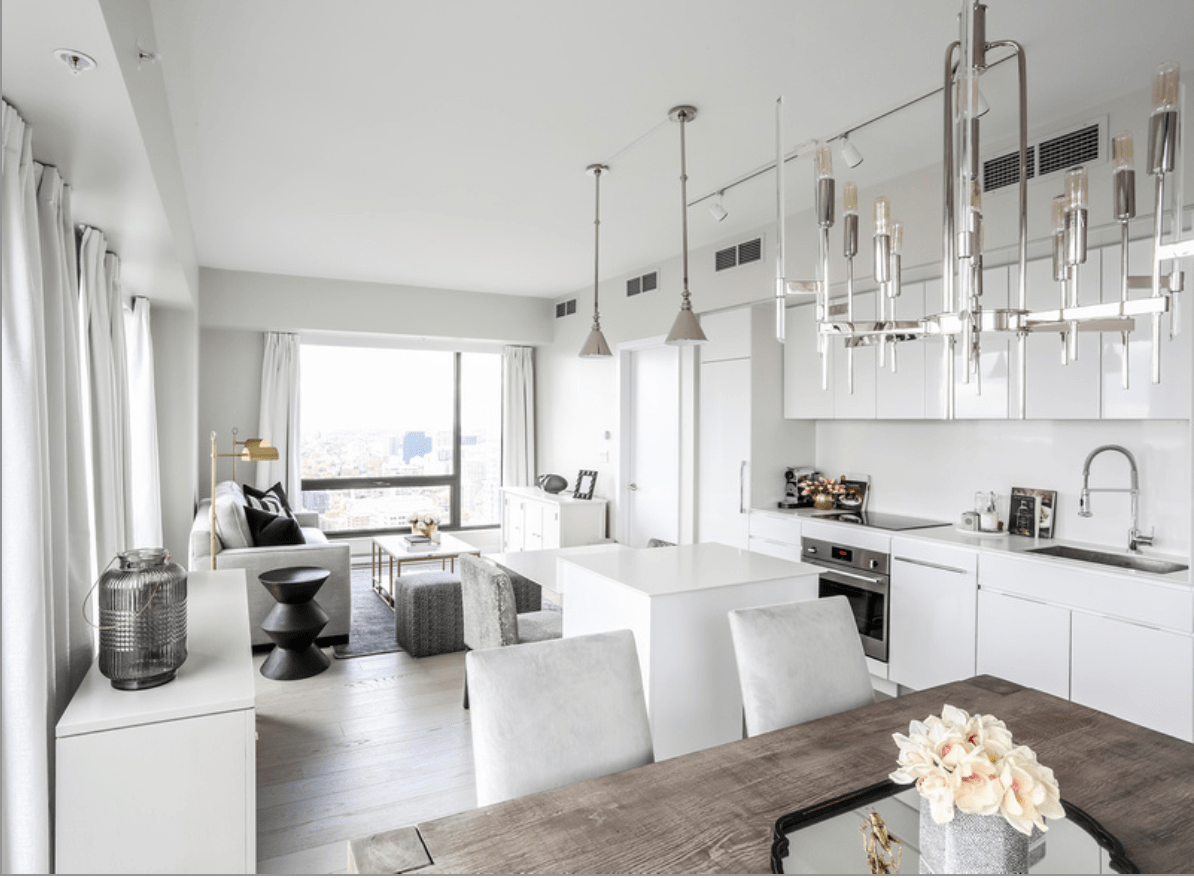 Modern, clean dining room, kitchen and living room in a small apartment.