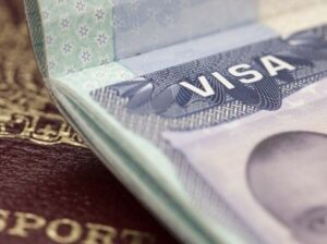 Open passport with view of a visa