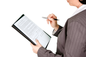 Woman holding clipboard with information outlining how to form an NGO in Uruguay