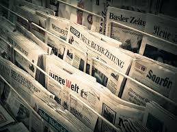 newspapers on a stand