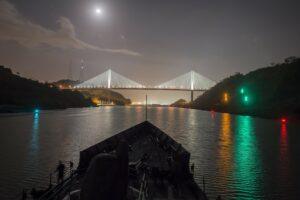 Ship travelling through Panama Canal at night.