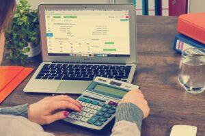 Accountant in Ecuador using laptop and calculator