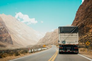 Truck driving along winding road