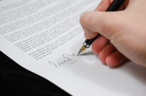 Signing Power of Attorney document for a legal representative in Costa Rica