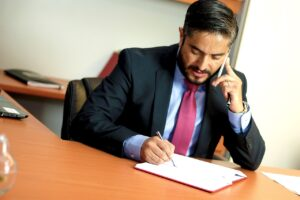 Legal Representative in Mexico signing a document