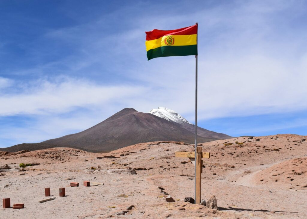 A mountain in Bolivia with the national flag.
