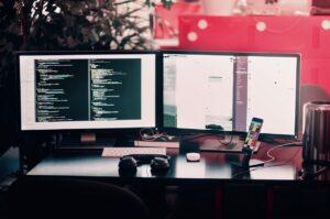 A computer on a desk with a tech program running.