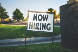 A sign saying now hiring because an employer of record company is searching for new employees.