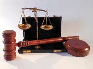 The scales of justice sitting in a briefcase with a Judge's gavel