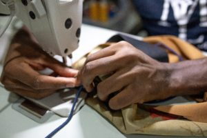 Person using a sewing machine in the Guatemala textile industry