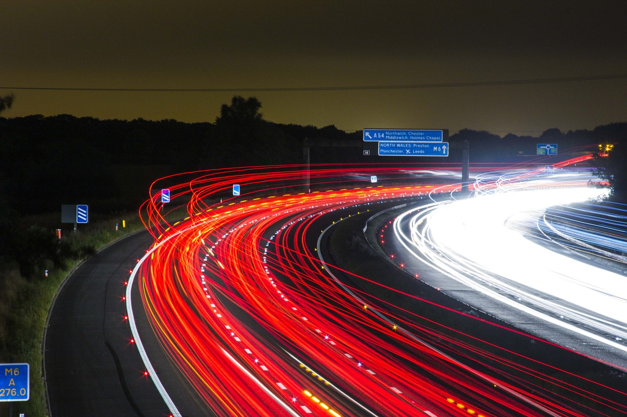 Cars driving on the highway at night