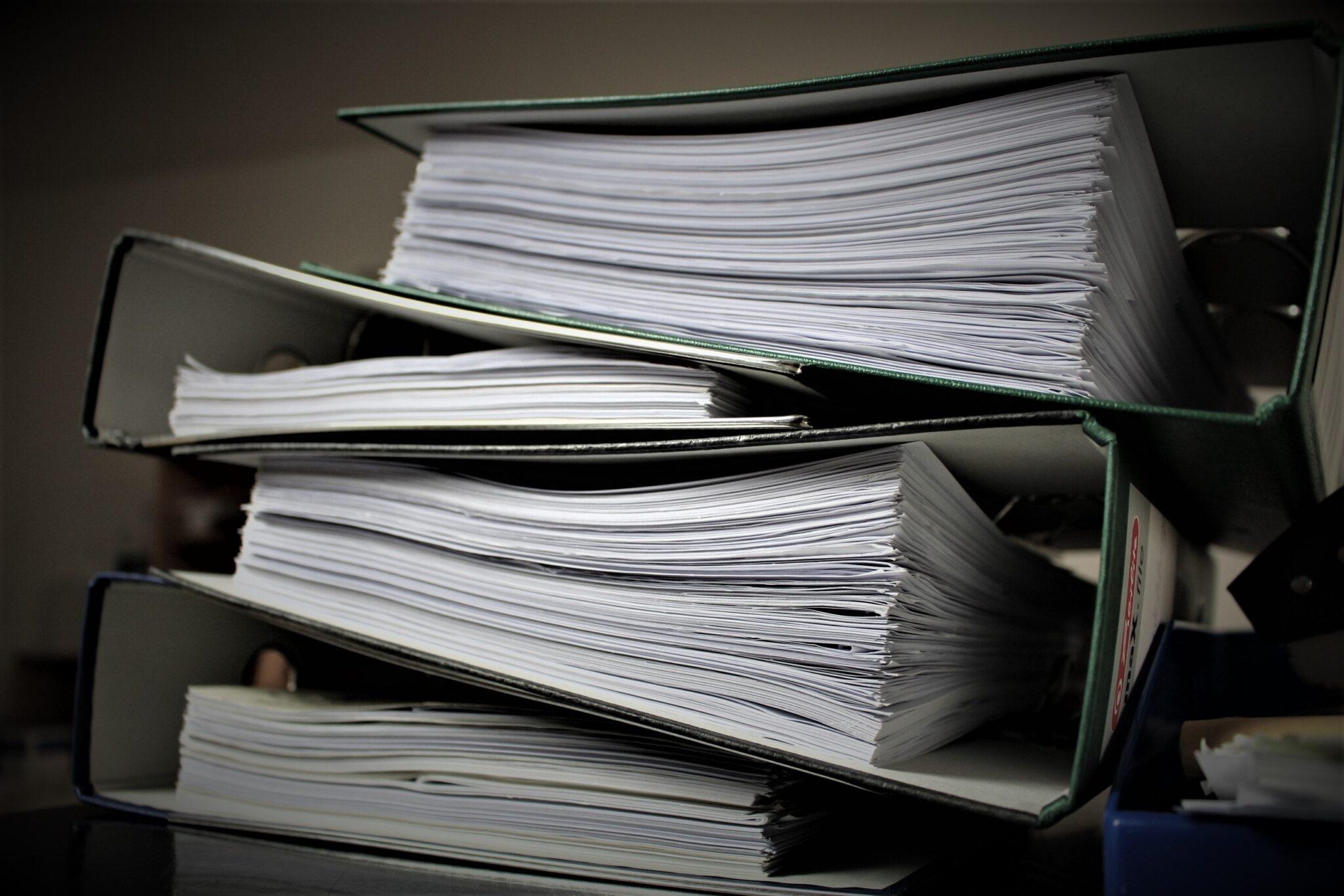 Stack of full binders