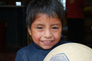 A child holding a football in Bolivia