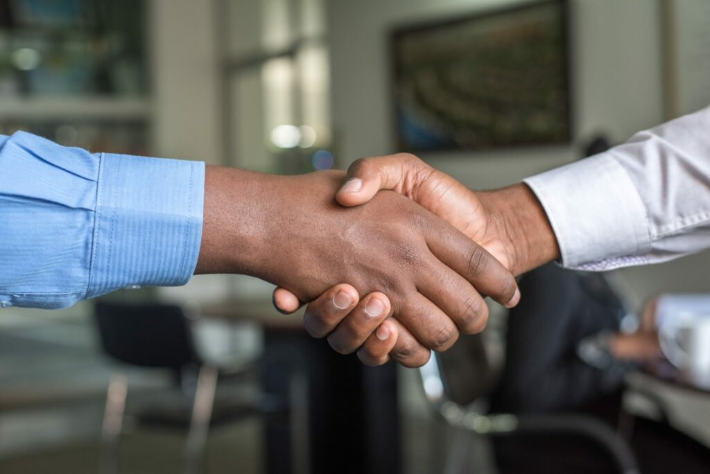 Two men shaking hands as part of a free trade agreement between Panama and Latin America