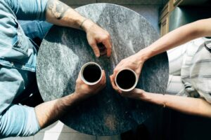 Two people having coffee together.