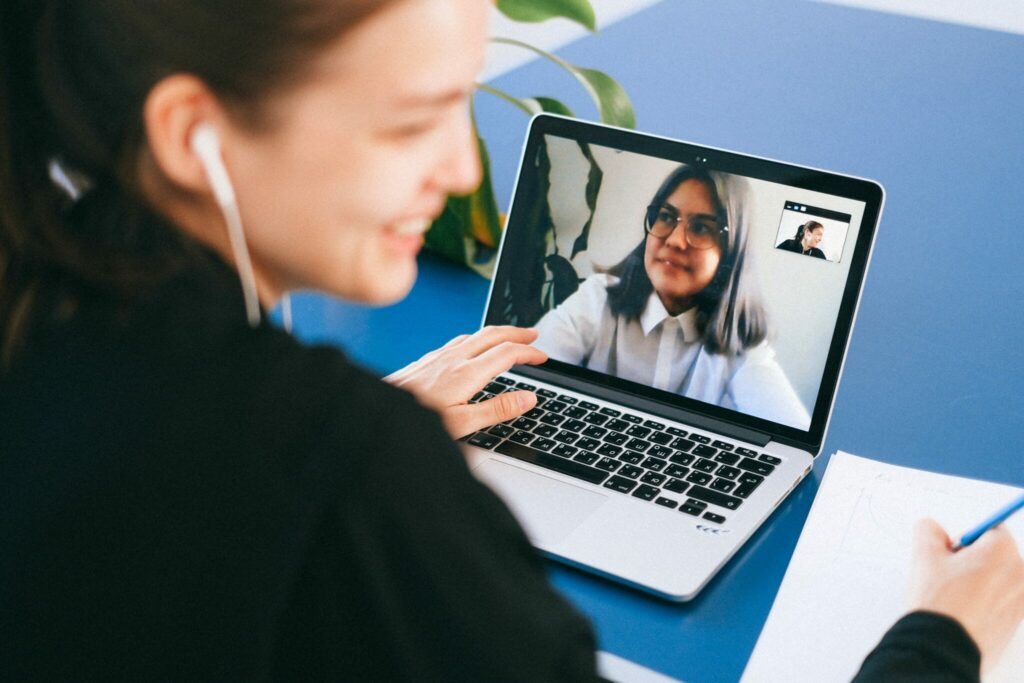 A woman working with an employer of record in Bolivia via a video call interview.