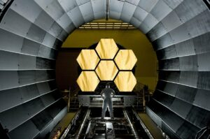Person standing inside a space telescope