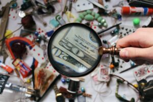 A magnifying glass verifying some documents related to an entity health check in Bolivia.