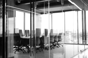 Black and white image of empty boardroom.
