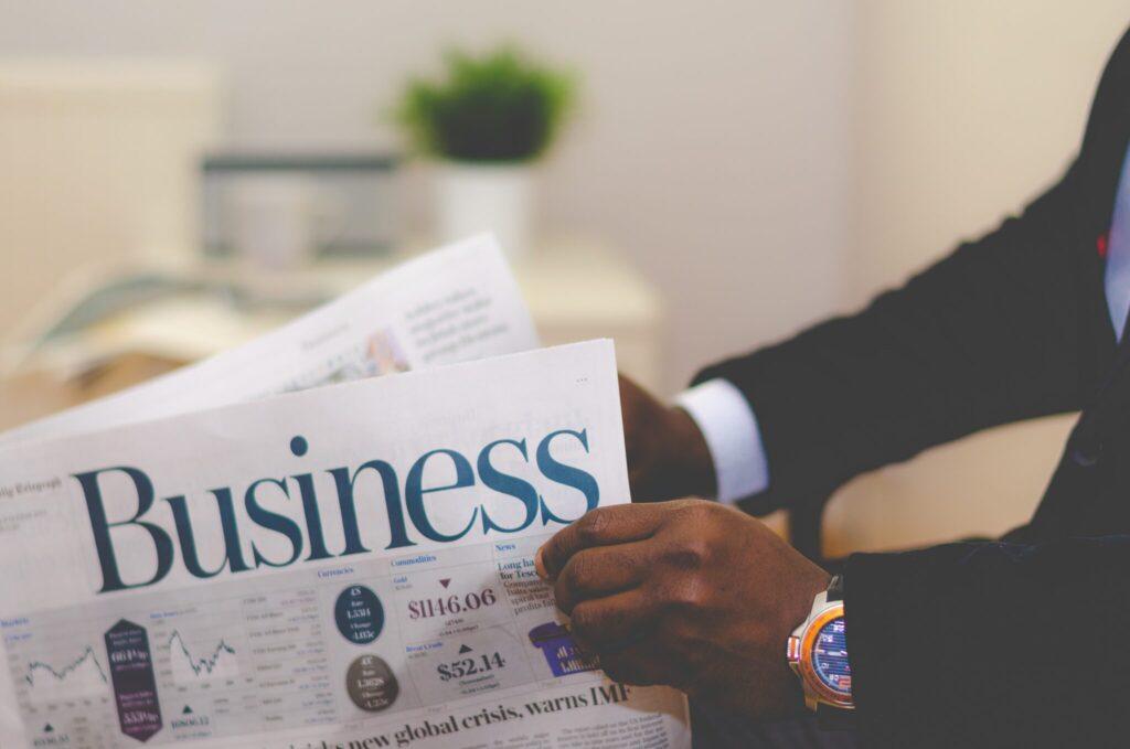 Man reading business newspaper.