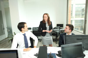 Biz Latin Hub staff discussing regulatory updates in August 2020