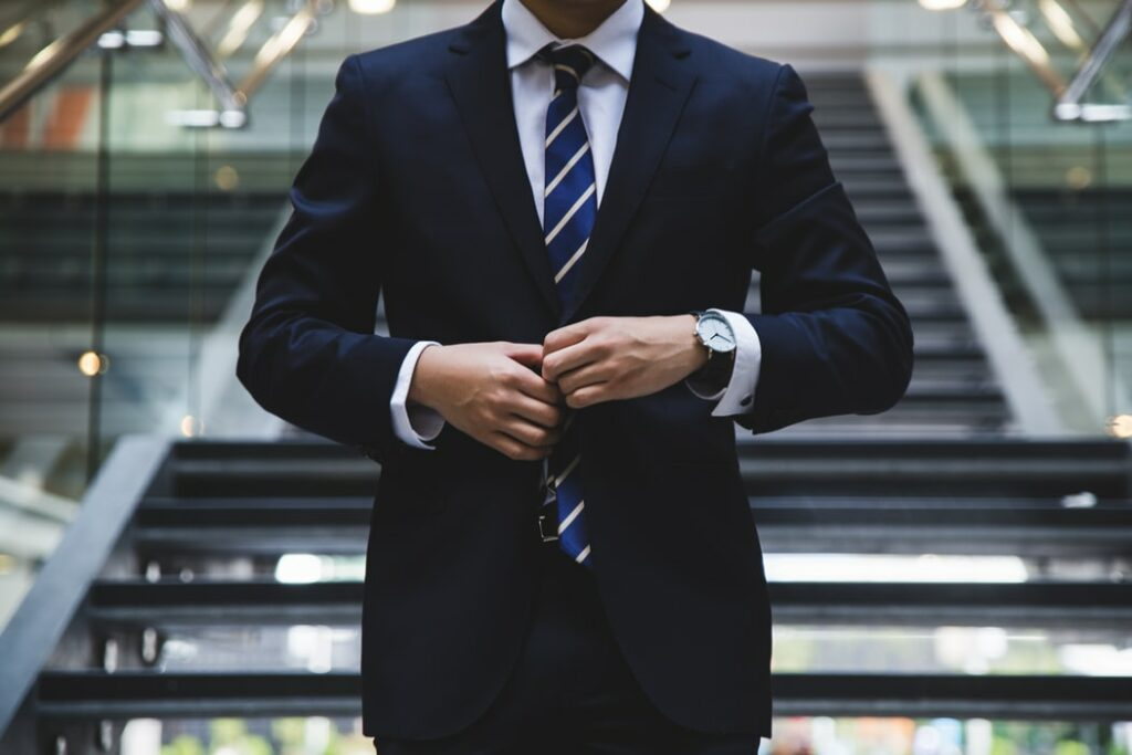 A photo of a suited professional representing an execurtive who is not eligible for PTU in Mexico