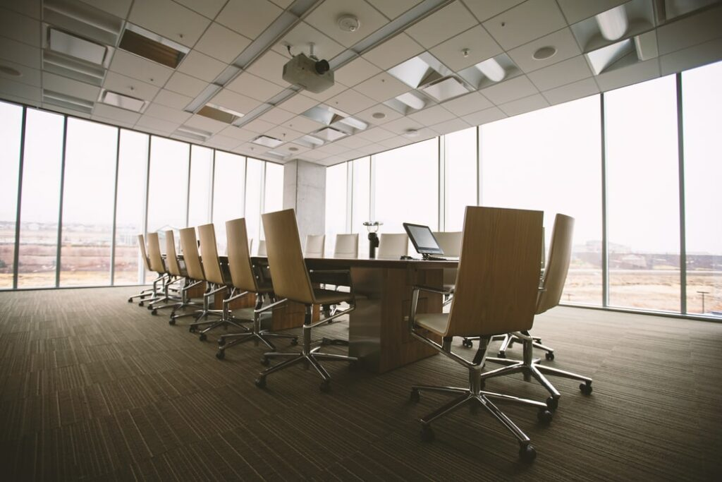 A photo of a  board room. Shareholders' meeting minutes must be circulated among board members as part of financial regulatory compliance in Chile