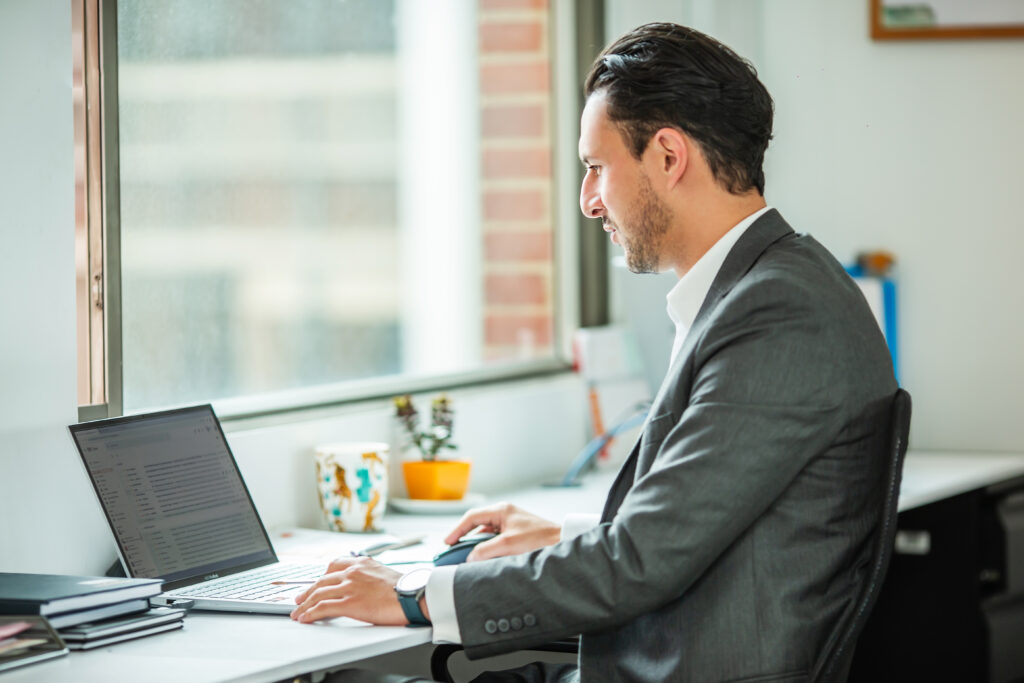 A Biz Latin Hub stock image representing a lawyer in Chile using a computer.