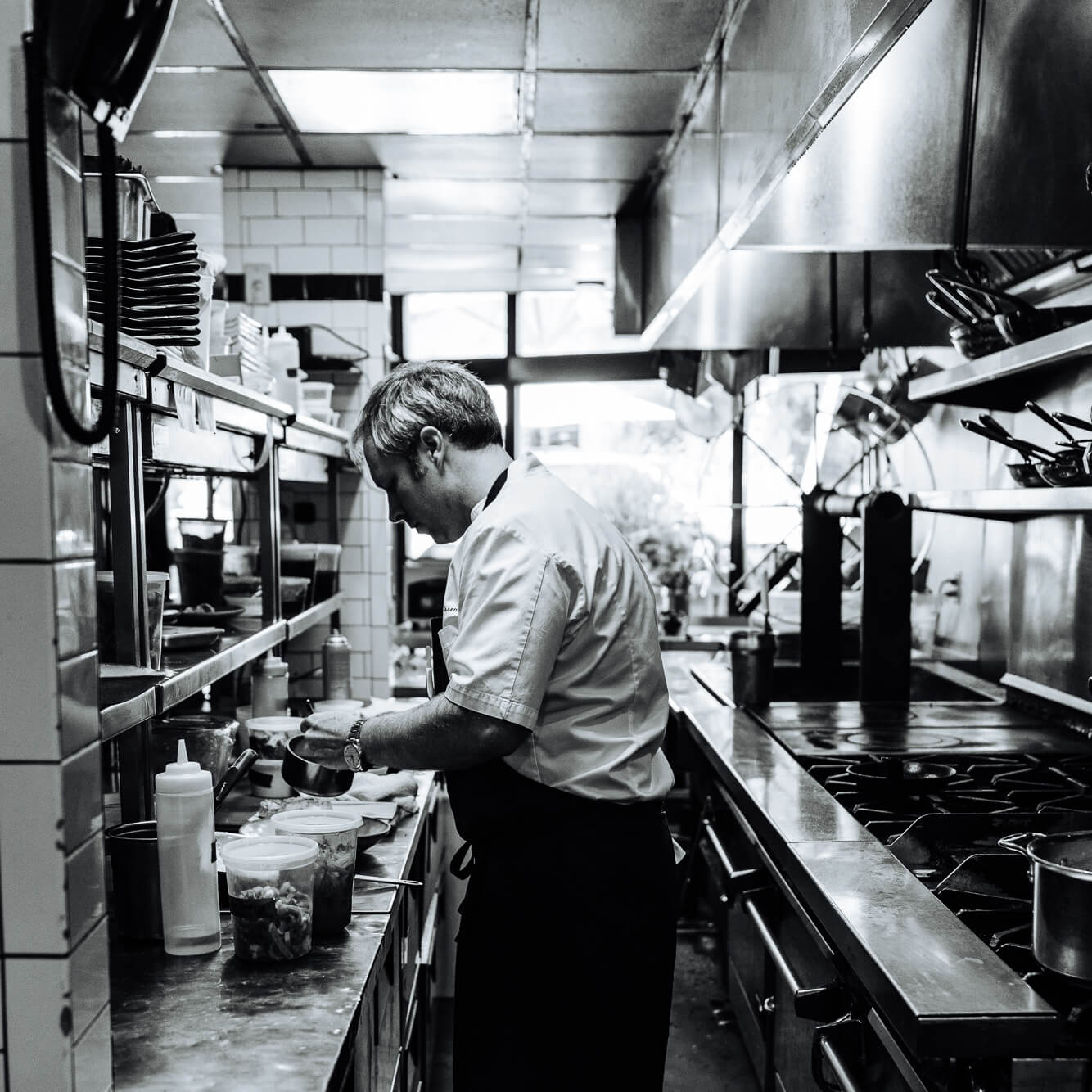 chef william dissen plating a farm to table dish