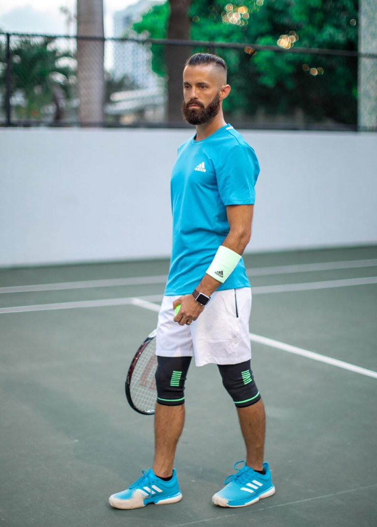Michael Checkers in Miami Beach modeling an Adidas tennis outfit