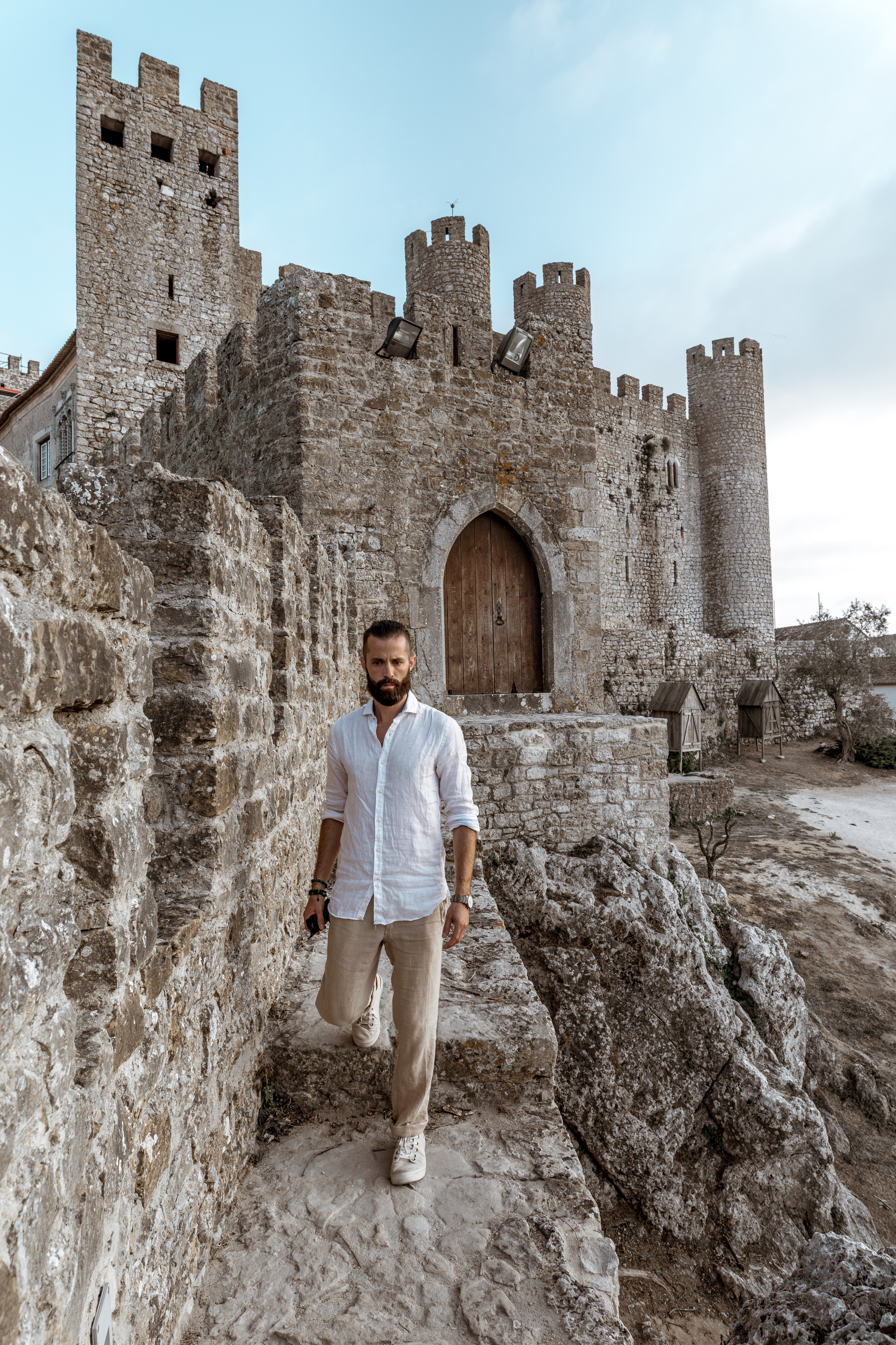 Michael Checkers men's street style blogger walking in a castle in Portugal