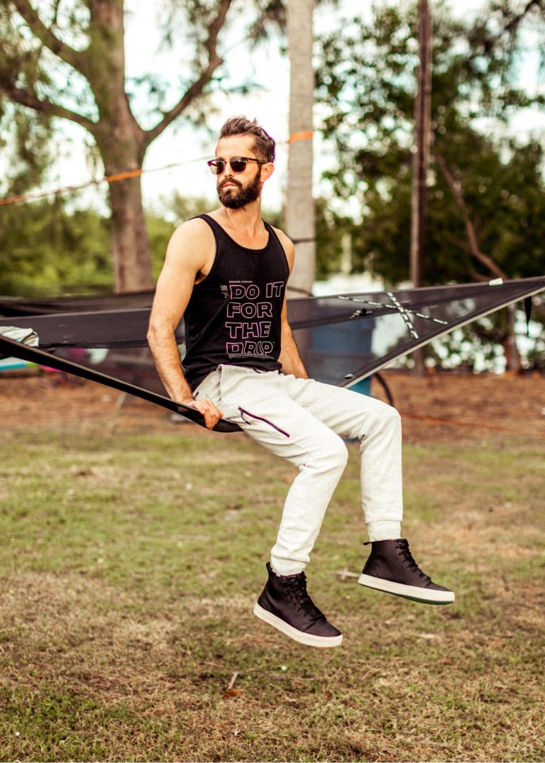 Michael Checkers sitting on a hammock in Miami wearing TOMS seankers