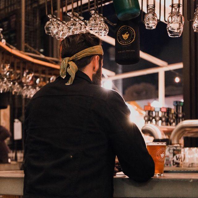 Michael Checkers at Wynnwood Brewery wearing a black denim jacket