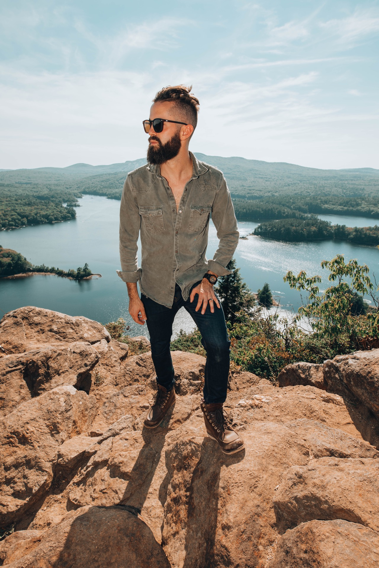 Michael Checkers modeling fall fashion trends for 2018 on a mountain top in Maine