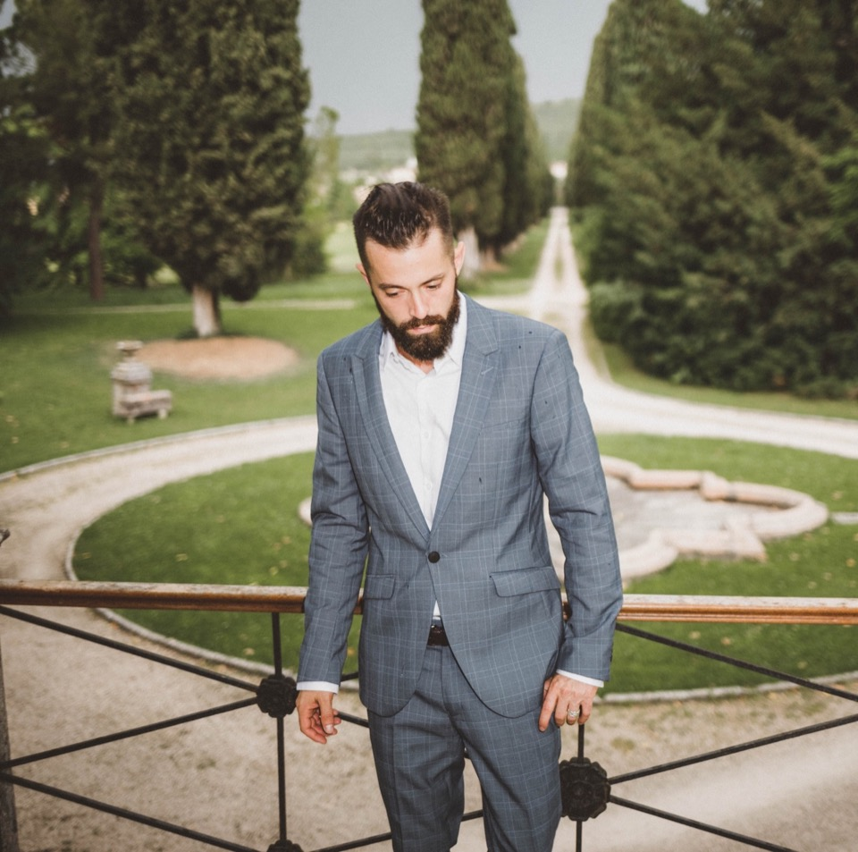 Michael Checkers modeling a Topman suit at a private villa in Italy
