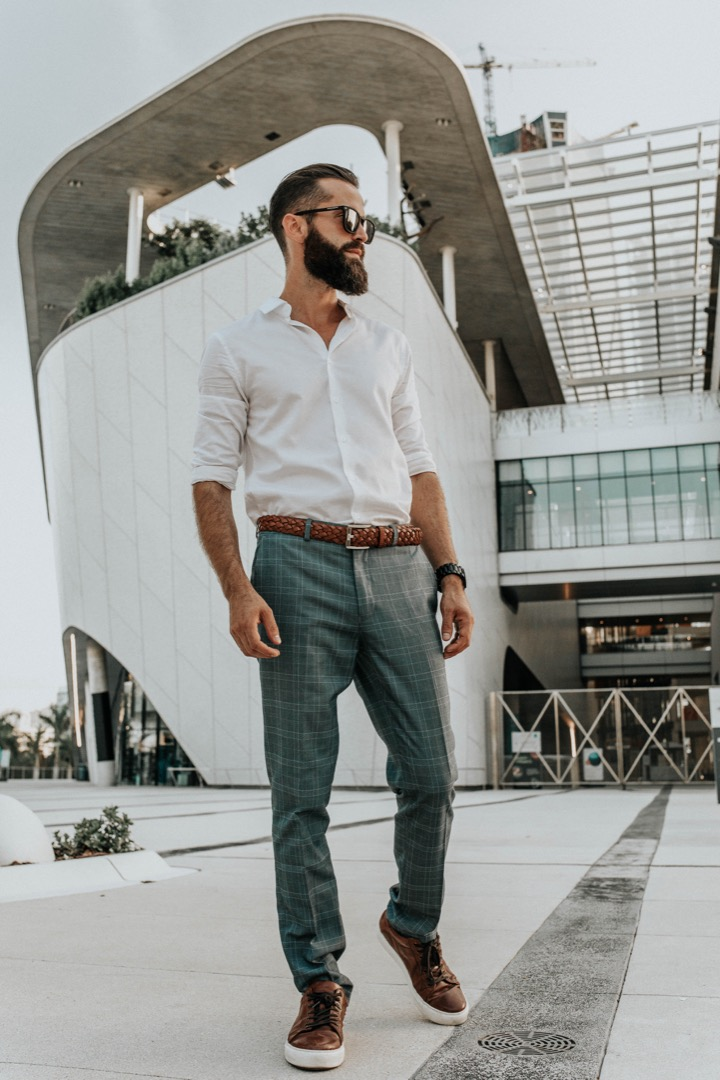 Michael Checkers wearing Biscayners sunglasses and Topman menswear in downtown Miami FL