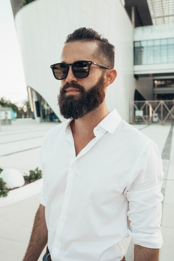 Michael Checkers modeling Biscayners sunglasses in Miami FL