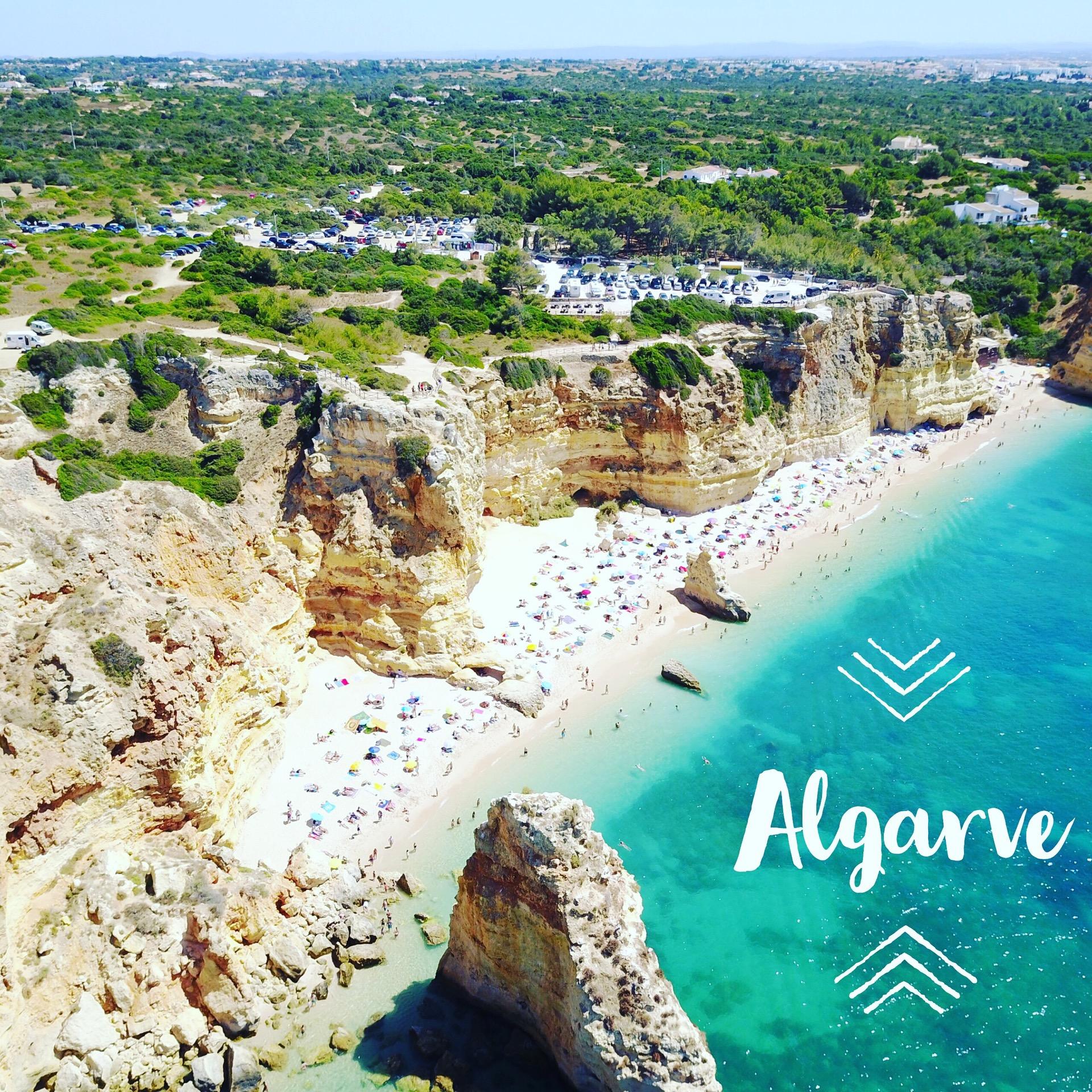 "Beach at Praia Marina Algarve Portugal with stylized text ""Algarve"" overlaid"