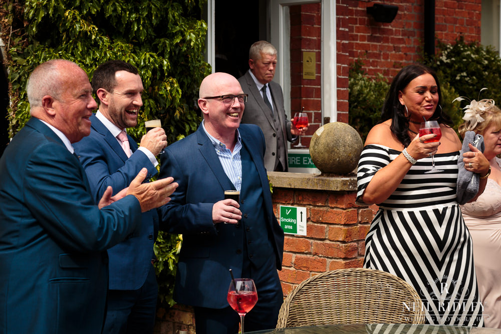Bartle Hall Wedding Photographer guests laughing in the garden