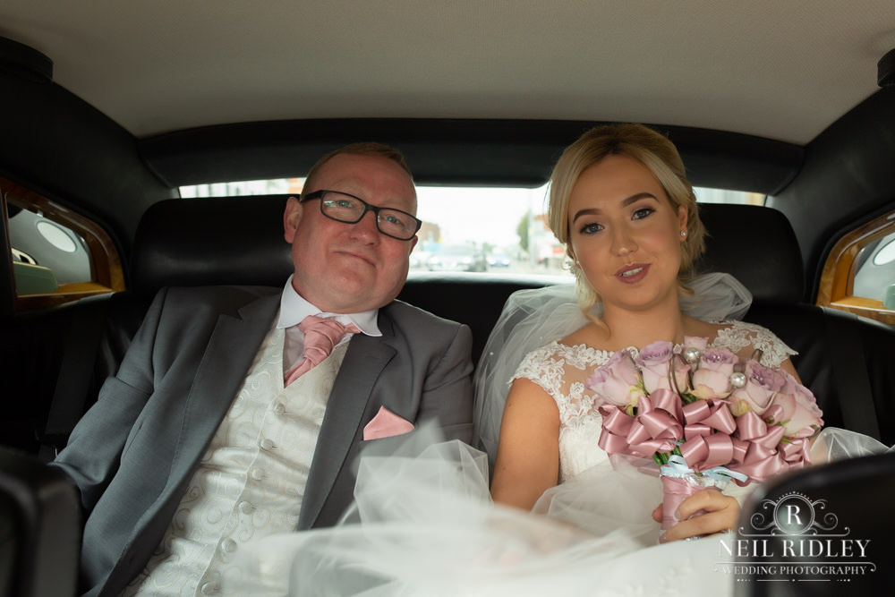 Manchester Wedding Photographer  bride and father in the wedding car